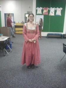 me in a pink 1580s Italian dress in a classroom