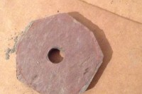 An octagon of slate with a hole in the middle