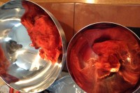 two metal bowls holding red wool