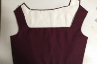 image shows inside of back bodice piece and outside of front bodice piece. Lining is white linen. Fashion fabric is burgundy wool.